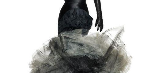 Textile, Sunglasses, Style, Costume accessory, Costume design, Fashion, Black, Gown, Costume, Ruffle,
