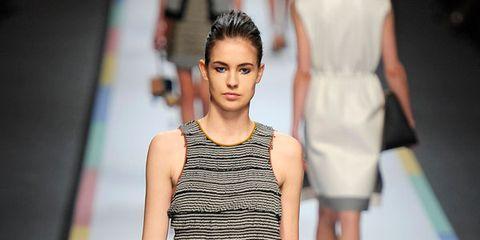 Clothing, Leg, Fashion show, Yellow, Event, Shoulder, Runway, Human leg, Dress, Joint,