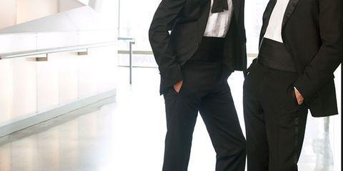 Clothing, Coat, Trousers, Suit trousers, Collar, Dress shirt, Shirt, Standing, Suit, Photograph,