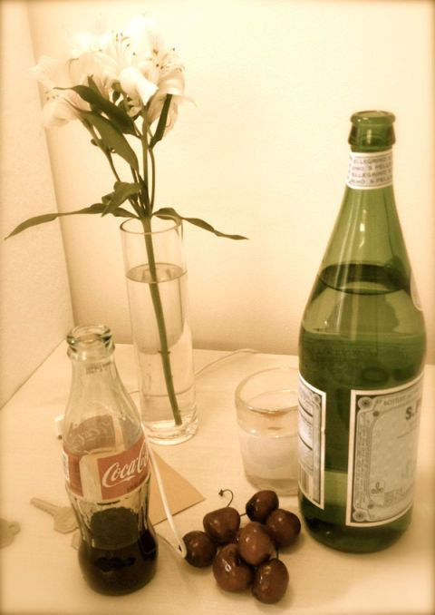 Glass bottle, Bottle, Drink, Drinkware, Liquid, Alcohol, Flower, Petal, Glass, Alcoholic beverage,