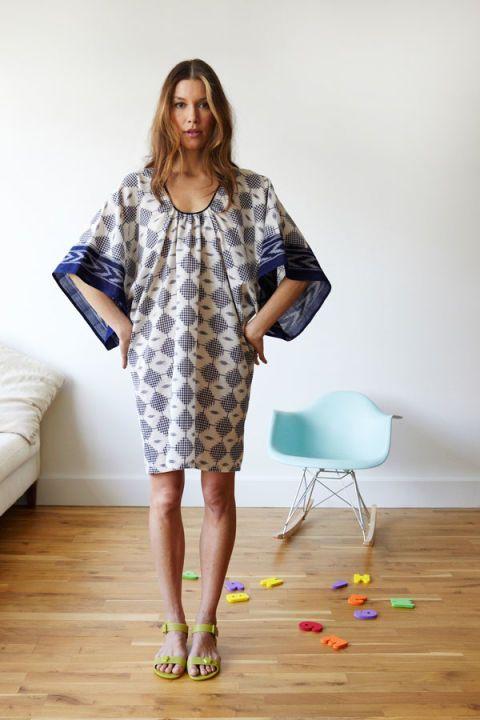 Clothing, Sleeve, Human body, Shoulder, Joint, Dress, Floor, Style, Flooring, One-piece garment,
