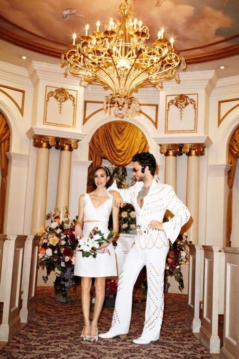 Lighting, Trousers, Photograph, Outerwear, Interior design, Coat, Light fixture, Formal wear, Ceiling, Dress,