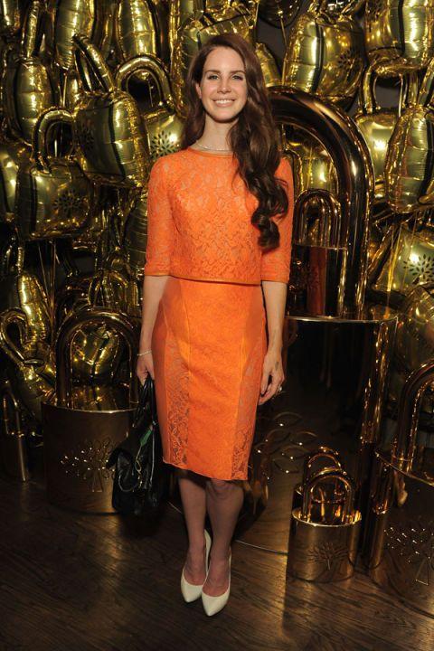Dress, Style, Amber, One-piece garment, Day dress, Long hair, Cocktail dress, Bag, Brass, Waist,