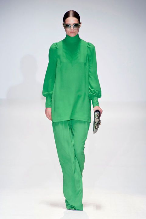 Clothing, Eyewear, Sleeve, Green, Shoulder, Textile, Standing, Joint, Style, Fashion model,