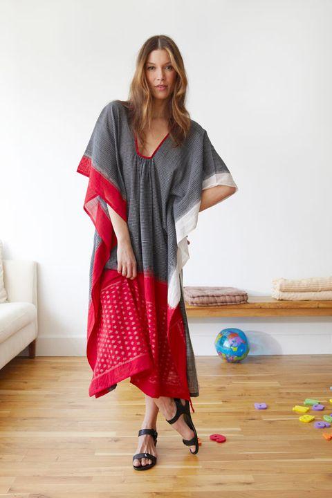 Sleeve, Textile, Floor, Flooring, Wood flooring, Laminate flooring, Sandal, Hardwood, Street fashion, Couch,