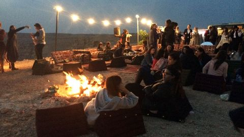 People, Social group, Heat, Fire, Sitting, Flame, Bonfire, Campfire, Crowd, Youth,