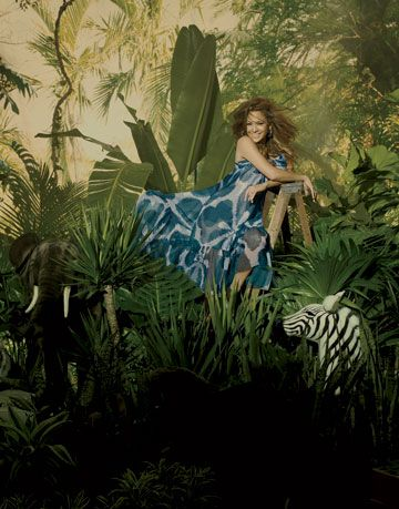 jennifer lopez posing as the queen of the jungle in a diane von furstenberg  gown and kara ross earrings
