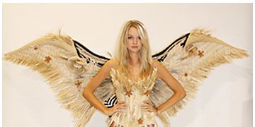 Hairstyle, Yellow, Wing, Angel, Art, Fictional character, Costume design, Fashion, Costume, Mythical creature,