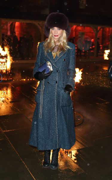 Textile, Winter, Coat, Hat, Street fashion, Overcoat, Fashion, Electric blue, Fur, Boot,