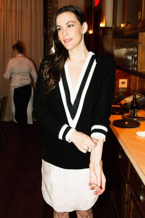 Leg, Shoulder, Textile, Joint, Style, Cabinetry, Countertop, Curtain, Kitchen, Black hair,