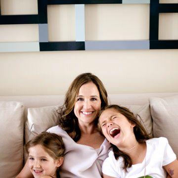 jamie wiatt sitting on a couch with her children