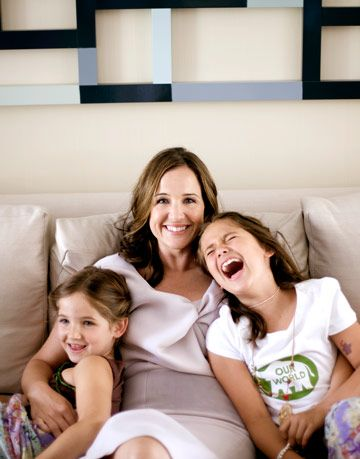jamie wiatt sitting on a couch with her children