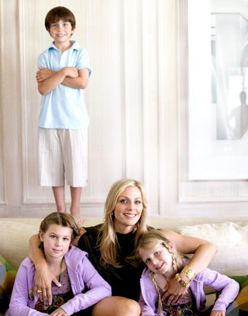 elizabeth tisch sitting with her children on a couch