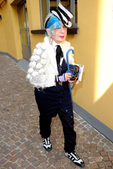 Trousers, Shoe, Costume accessory, Headgear, Street fashion, Headpiece, Sneakers, Hair accessory, Costume hat, Costume,