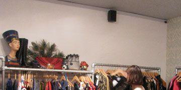 Retail, Textile, Room, Clothes hanger, Fashion, Boutique, Market, Outlet store, Human settlement, Fashion design,