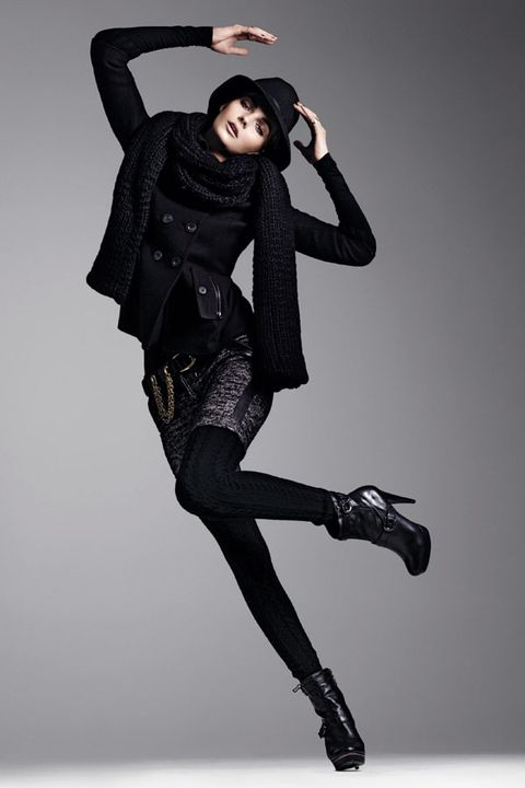 Sleeve, Human leg, Joint, Style, Knee, Fashion model, High heels, Thigh, Fashion, Black,