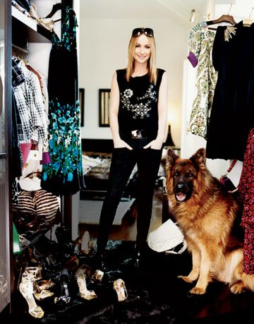 The designer and her German shepherd, Gunner, pose in her closet packed with Gucci classics.