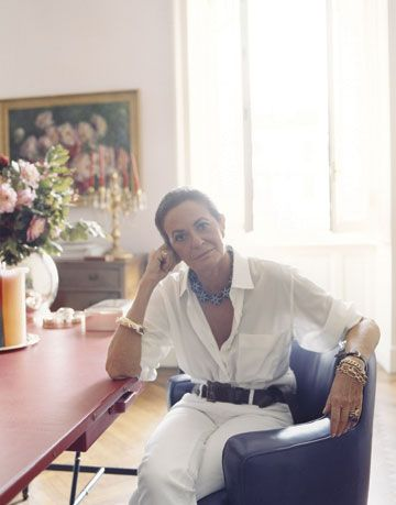 rosella jardini in her home sitting at her hermes desk in her favorite gio ponte chair