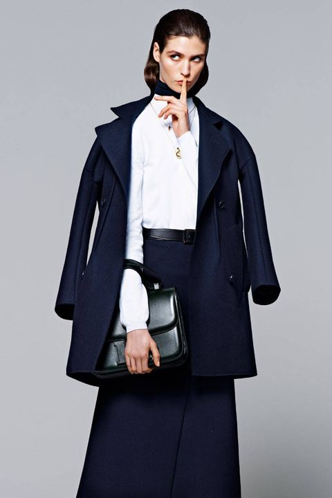 Clothing, Collar, Sleeve, Human body, Shoulder, Coat, Textile, Standing, Joint, Outerwear,