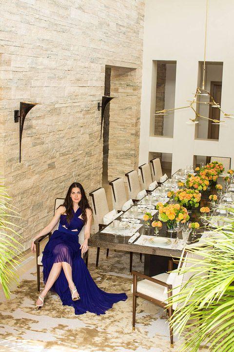 Dress, Outdoor furniture, Bouquet, Flowerpot, Waist, Flower Arranging, One-piece garment, Floristry, Cut flowers, Outdoor table,