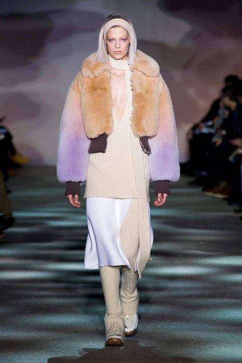 Fashion show, Human body, Outerwear, Runway, Style, Fashion model, Winter, Fashion, Costume design, Knee,