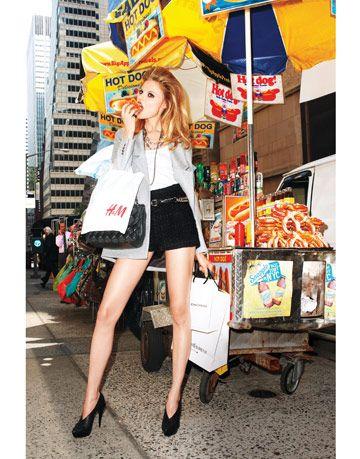model eating a hot dog