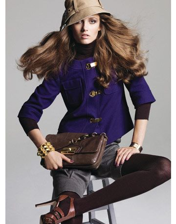 model in purple jacket