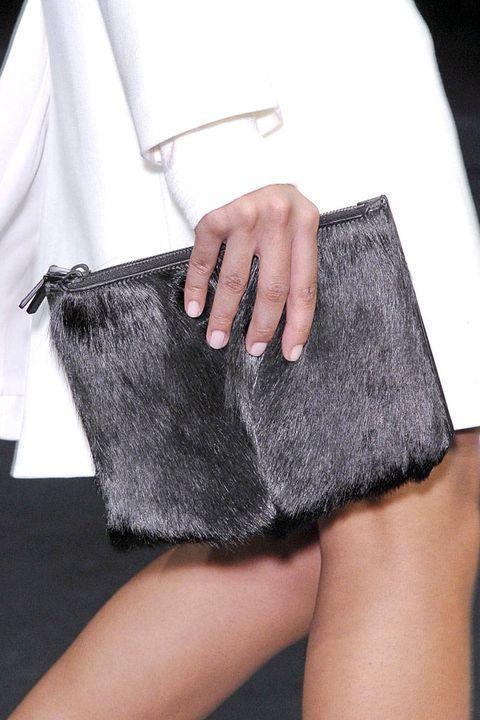 Textile, Fashion, Black, Nail, Material property, Shoulder bag, Cuff, Pocket, Silver, Fashion design,