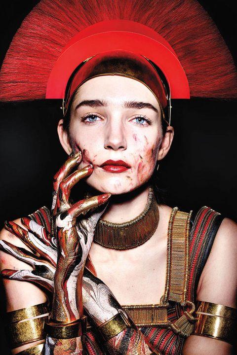 Headgear, Costume, Portrait photography, Portrait, Costume accessory, Throat, Flesh, Body jewelry, Body piercing, Eye liner,
