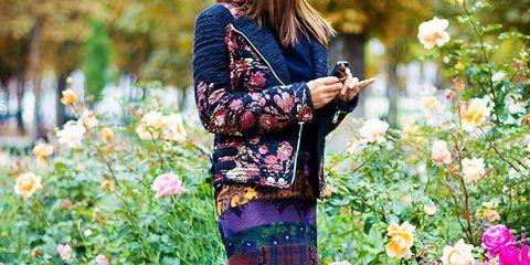 Plant, Flower, Shrub, Petal, People in nature, Garden, Street fashion, Spring, Bag, Flowering plant,