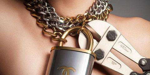 Lip, Tooth, Eyelash, Fashion, Body jewelry, Metal, Eye liner, Chain, Earrings, Brass,