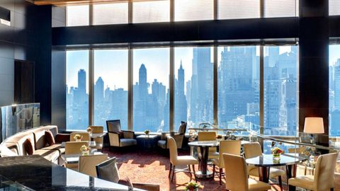 Interior design, Glass, Tower block, Furniture, Room, Apartment, Commercial building, Real estate, Table, Skyscraper,