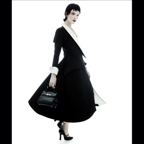 Sleeve, Shoulder, Bag, Standing, Formal wear, Style, Fashion accessory, Fashion, Luggage and bags, Black,