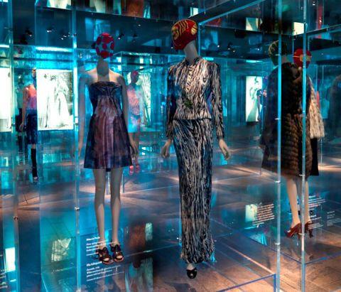 Dress, Mannequin, One-piece garment, Fashion model, Fashion, Retail, Waist, Transparent material, Cocktail dress, Display window,