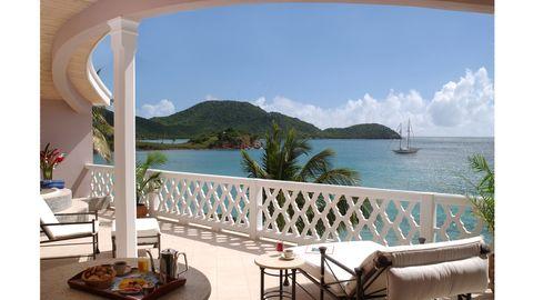 Property, Furniture, Outdoor furniture, Coastal and oceanic landforms, Real estate, Resort, Table, Watercraft, Outdoor table, Seaside resort,