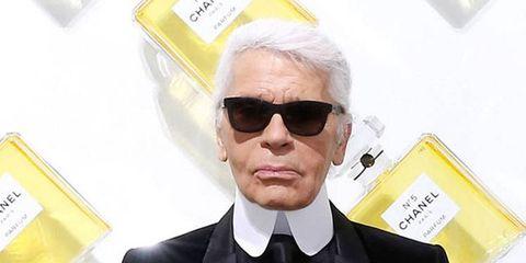 Eyewear, Vision care, Coat, Glasses, Yellow, Collar, Dress shirt, Outerwear, Suit, Sunglasses,
