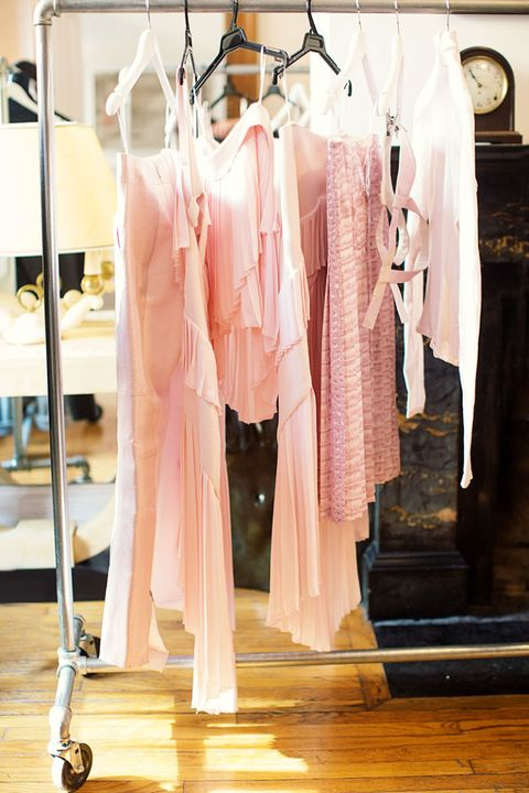 Clothes hanger, Room, Home accessories, Boutique, Retail, Clock, Peach, Outlet store, Fashion design, Closet,