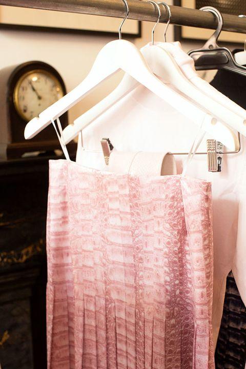 Textile, Clothes hanger, Home accessories, Linens, Wall clock, Silver, Clock,