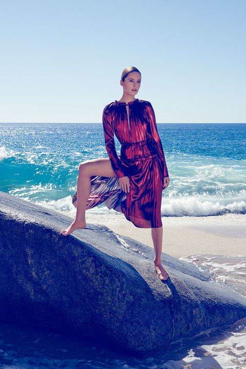 Human leg, Dress, Ocean, Leisure, Coastal and oceanic landforms, Summer, People in nature, Beauty, Aqua, Vacation,
