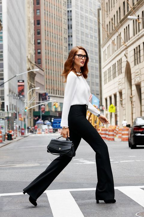 Clothing, Sleeve, Trousers, Urban area, Standing, Outerwear, Street, Sunglasses, Building, Style,