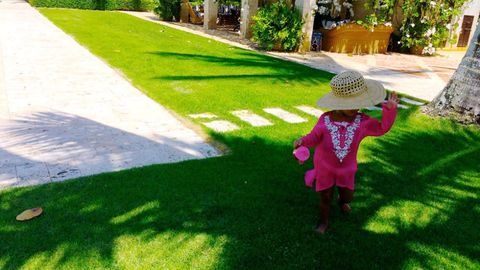 Grass, Green, Hat, Garden, Lawn, Costume accessory, Grass family, Yard, Sun hat, Walkway,