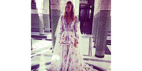 Textile, Dress, Purple, Gown, Street fashion, Wedding dress, One-piece garment, Long hair, Fashion design, Day dress,