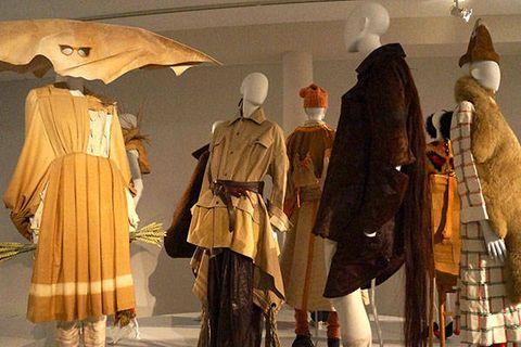Headgear, Fashion, Costume design, Mannequin, Armour, Costume, Fashion design, Umbrella, Fur, Collection,