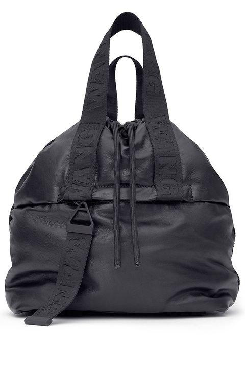 Textile, Outerwear, Bag, Black, Leather, Zipper, Pocket, Fashion design, Vest,