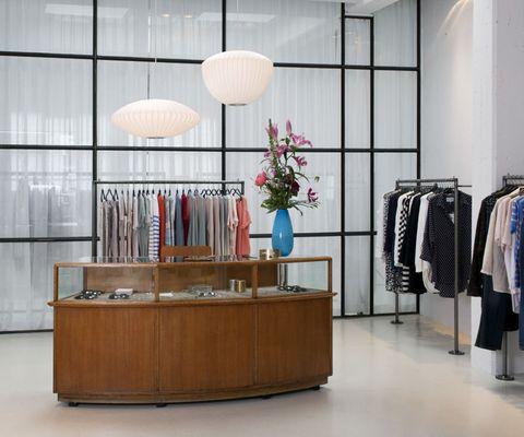 Room, Interior design, Clothes hanger, Floor, Hardwood, Light fixture, Varnish, Interior design, Material property, Ceiling fixture,