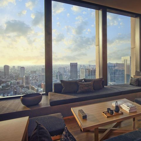 Room, Table, Interior design, Glass, Furniture, Apartment, Tower block, Floor, Coffee table, Wall,