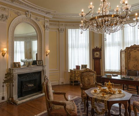 Interior design, Room, Lighting, Table, Furniture, Light fixture, Ceiling, Interior design, Hearth, Floor,