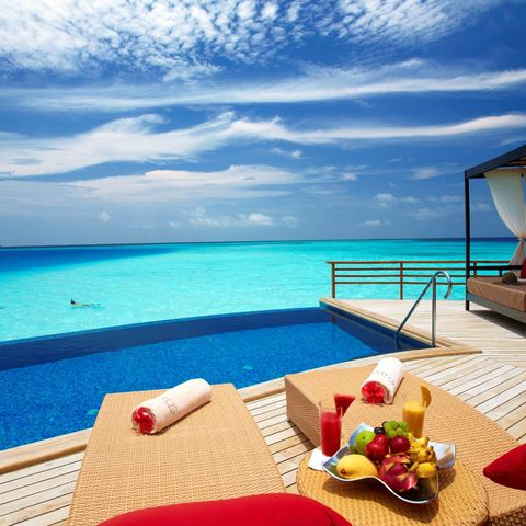 Blue, Coastal and oceanic landforms, Cloud, Resort, Ocean, Aqua, Fluid, Turquoise, Furniture, Outdoor furniture,
