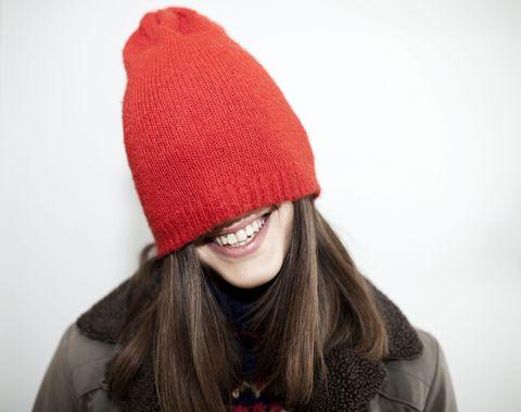 Lip, Textile, Winter, Red, Outerwear, Headgear, Costume accessory, Maroon, Carmine, Pattern,