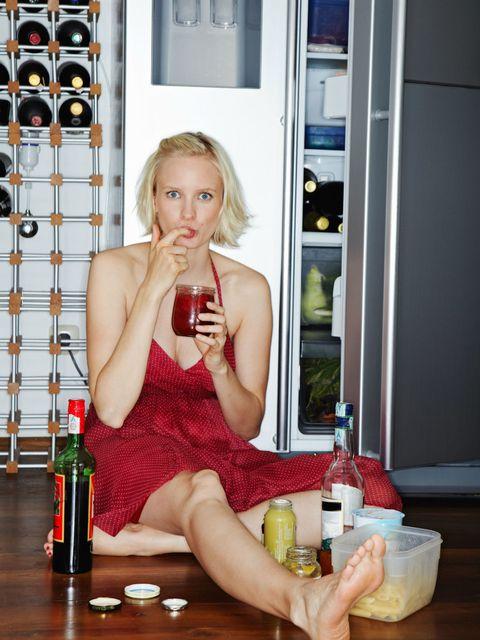Hand, Drinkware, Drink, Bottle, Alcohol, Alcoholic beverage, Distilled beverage, Glass bottle, Tableware, Liqueur,
